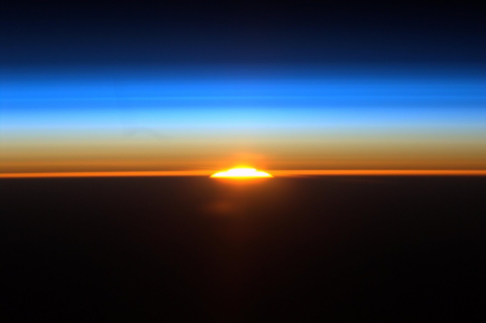 1489697625454230 582752main sunrise from iss full full
